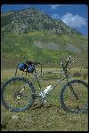 Cook Brothers bike standing in field, Crested Butte, CO, September 1979. Built in Santa Ana, CA. Owned by Chris Carroll of Bicycles, Etc., Crested Butte, CO. Chrome plated, blue parts. Static side view