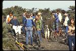 Top of Repack, discussing start times, socializing and releasing prerace tensions. More than 20 people including Bob Burrowes, with Marin County Klunkers T shirt, Les Degan, Wende Cragg, loading film , January 1979.